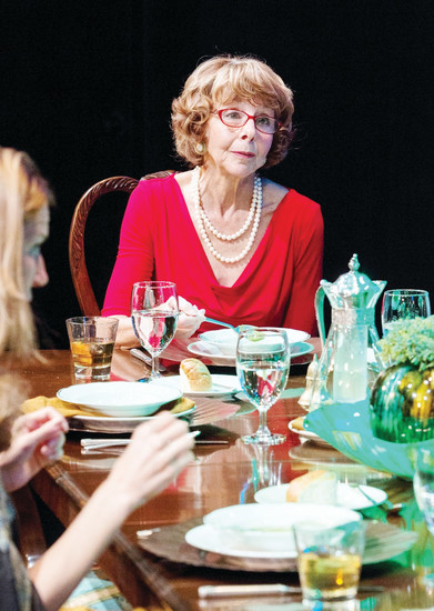 "Paige (Carol Bloom) hosts a dinner party for her author husband  that goes darkly awry in ""Dinner,"" at The Edge Theater through Sept. 17."
