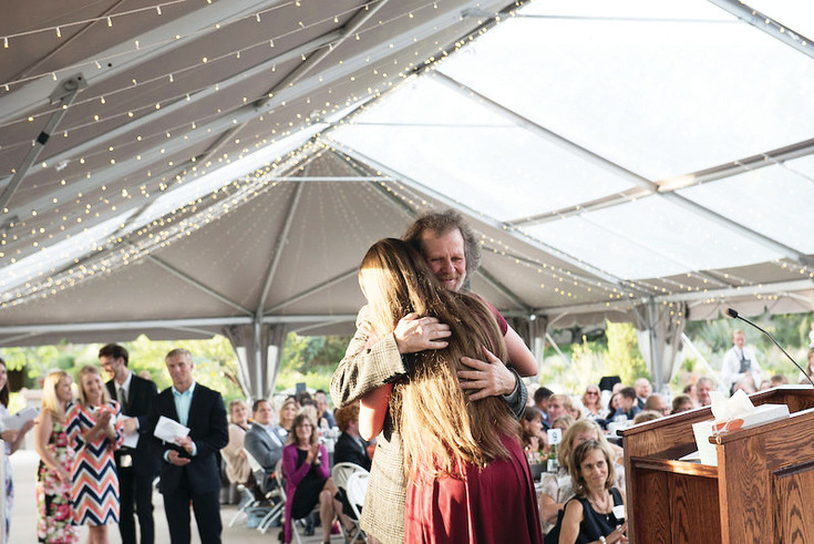 Roger Felch, a teacher at Castle View High School, hugs student Jenna Trost, who selected him for the Boettcher Foundation award. Felch was one of five teachers who were recognized at a July ceremony at the Denver Botanic Gardens.