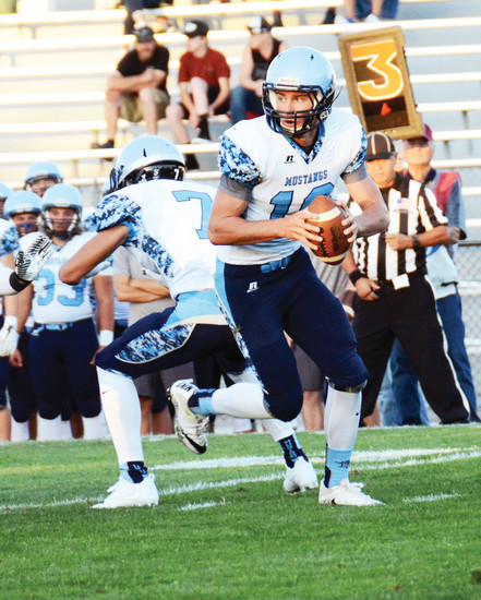 Ralston Valley junior quarterback AJ Jergensen (16) rolls out of the pocket during the Mustangs' season opener Aug. 25 at Jeffco Stadium. Jergensen made is first varsity start at quarterback in Ralston Valley's 21-7 loss to Columbine.