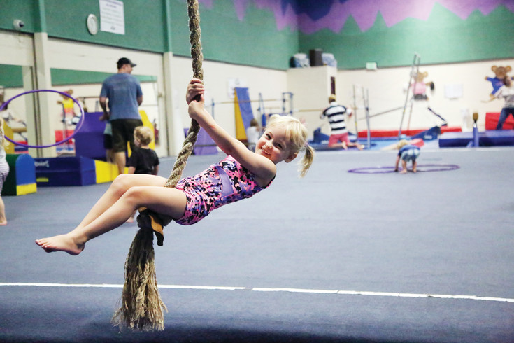 Olive McKenney, 4, attends open gym at the Simms Street Recreation Center regularly. The rope swing, she said, is her favorite.