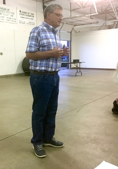 Elbert County Commissioner Grant Thayer helps answer citizens' questions at the Aug. 29 county water study meeting.