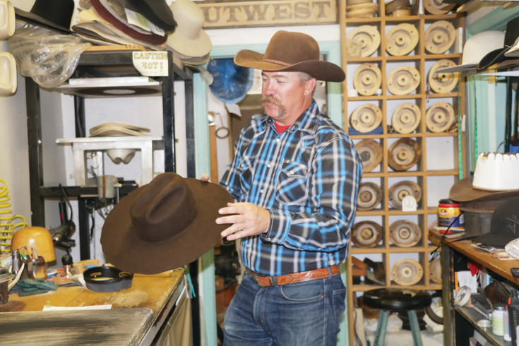 Brook Briddle checks the creases he has put in the crown of a beaver felt Western hat he is making for a customer. The process begins with raw hat body that Briddle's skills will transforminto a Western hat custom-made for its new owner. Briddle has cleaned, repaired and custom-made Western hats in for 14 years in his Powder River hat shop on Main Street in Elizabeth.