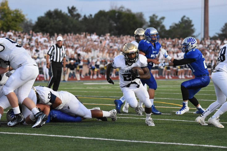 Broomfield senior running back Jalon Torres (35) advances into the Legacy secondary and is met by defensive back Ryan Lynch (2) during first quarter action, Sept. 2 , 2017 in Broomfield. Legacy defeated Broomfield 14-9. This year's rematch was Sept. 1 and was hosted by Legacy.
