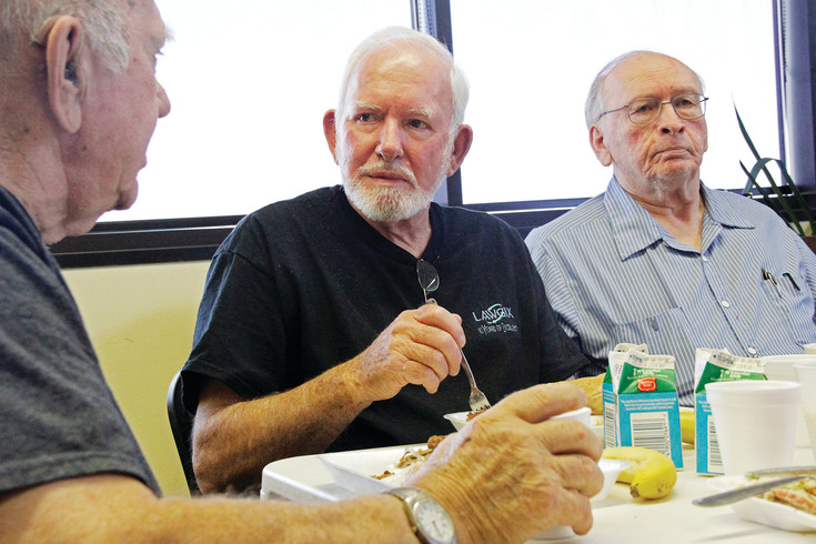 "Castle Rock resident Buzz Bowers, center, holds court with his friends John Dammann, left and Herb Wager at the Castle Rock Senior Activity Center on Aug. 29. The three Castle Rock residents get together each Tuesday, Thursday and Friday, to share a meal and, as Bowers says, their ""childhood adventures."""