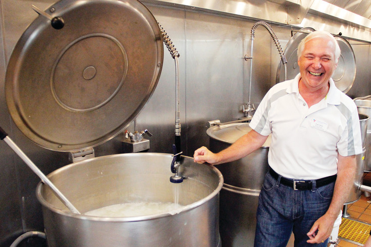 Dale Elliott, division director for Aging and Nutrition Services for the Volunteers of America, has a laugh while a kettle at the Denver VOA kitchen gets a wash. Elliott says the organization reaches out to private individuals and corporations for Meals on Wheels revenue, but most people don't appreciate the need for the program until they need it for themselves or a family member.