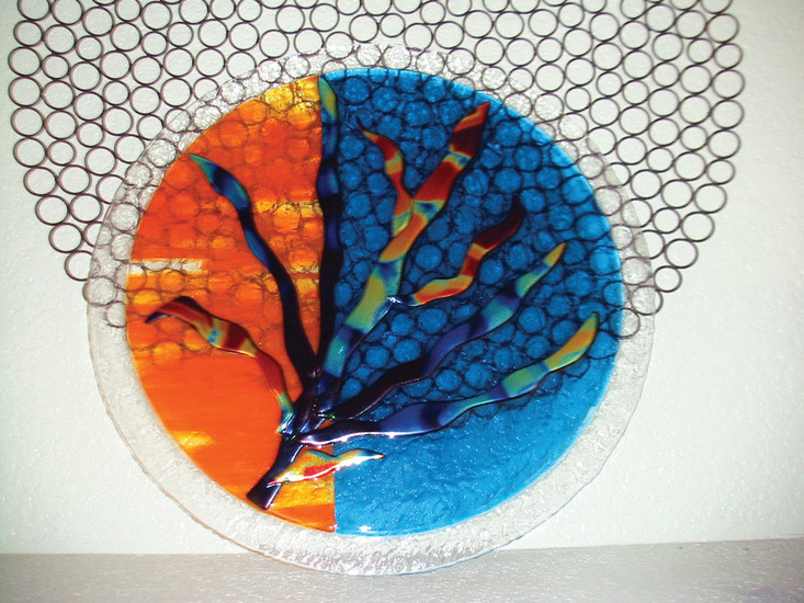 Pamela McCann creates fused glass art pieces. she is one of over 20 artists showing at the Arts and Ales event.