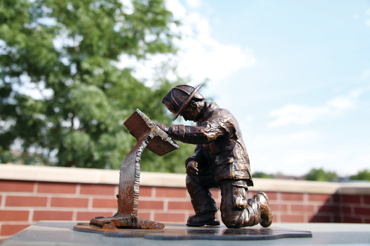 This tiny replica of the memorial Friends of Arvada Fire hopes to build will be at all fundraising events.
