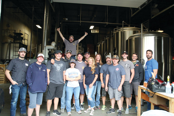 Members of the Arvada Fire Department joined staff at Odyssey Beerwerks Sept. 5 to brew the Old Dodge Ale.