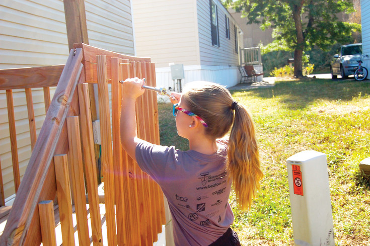 A young lady works on a handrail project during last year's Be A Tool's Day of Service. This year, the Day of Service takes place takes place on Sept. 9 in Golden, Englewood and Idaho Springs; and Sept. 16 in Arvada. At least 800 people are expected to volunteer this year throughout the four cities.