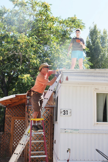 Two people become human tools during last year's Be A Tool's Day of Service event. The annual Day of Service started seven years ago in Golden, and has now expanded to Englewood, Idaho Springs and Arvada. More than 80 households will benefit from the volunteers' help during this year's Day of Service.