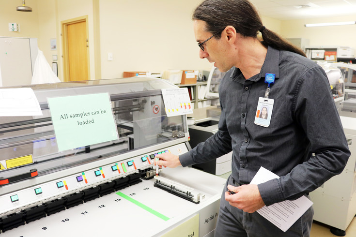 Bert Hargrave, St. Anthony Hospital's lab supervisor, explains how some of the blood testing machinery works. The lab generates close to 1.5 million billable tests annually.