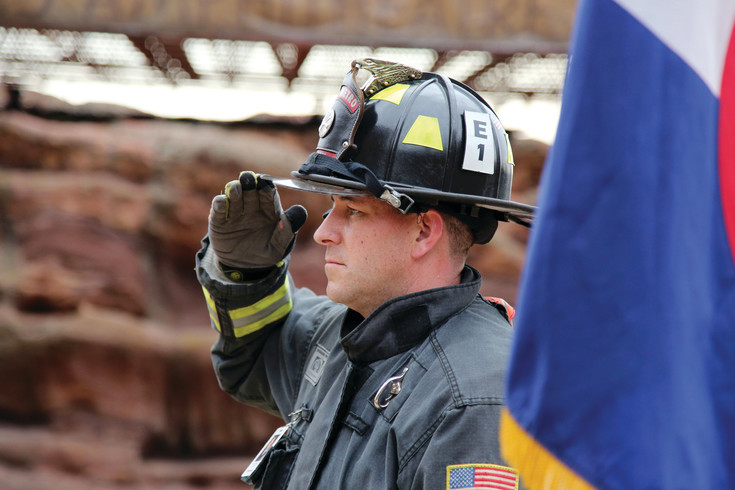 Tyler Hecox, of West Metro Fire, salutes the flag during the opening ceremony of the ninth annual Colorado 9/11 Stair Climb held Sept. 11 at Red Rocks.
