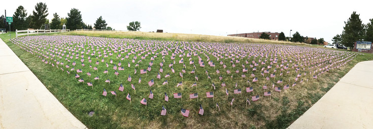 A group of Highlands Ranch High School students placed 2,977 American flags on a lawn near Highlands Ranch High School, at the corner of University Boulevard and Cresthill Lane, to represent the lives lost iin 9/11.