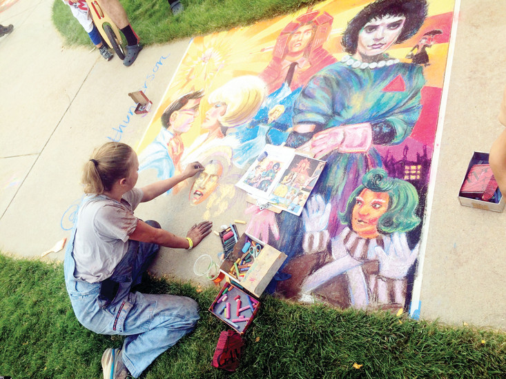Elena Gunderson nears the end of her chalk creation at RidgeFest. Gunderson worked on the piece for 10 hours.