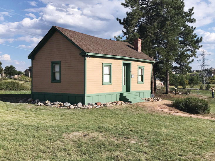 New paint and fresh landscaping highlight the Tallman/Newlin Cabin on Aug. 26, after approximately 60 community members came together to restore the cabin and nearby Newlin Cemetery.
