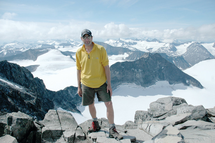 John Jancik stands atop Norway's highest mountain, Galdhøpiggen, the tallest mountain in all of Scandinavia and northern Europe. Jancik says the greatest feeling of accomplishment he's had was upon reaching the top of Granite Peak, the highest mountain in Montana and the last peak in the United States to be climbed in 1923.