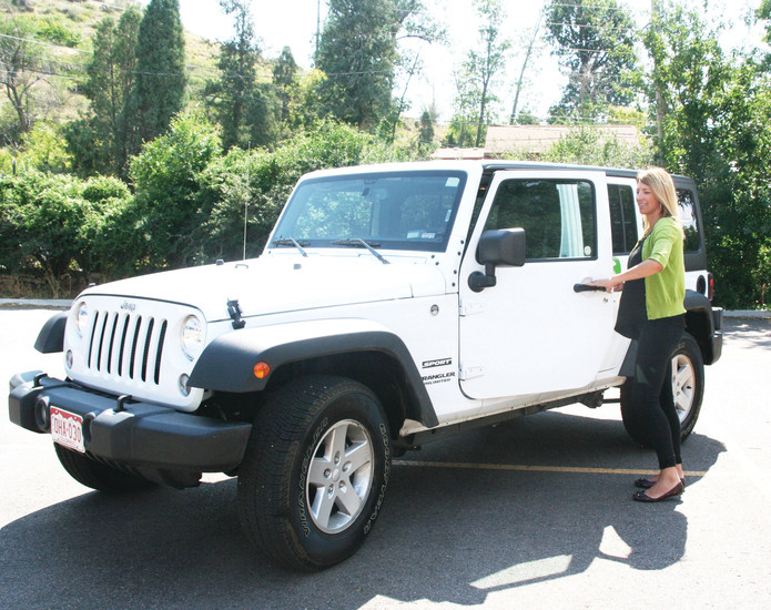 Zipcar General Manager Nicole Dalmy gets ready to take a Jeep Wrangler out on errands in Golden. Zipcar, a worldwide car-sharing network, recently expanded its service in Golden — and now has cars available for rent at the Colorado School of Mines campus parking garage located at 1250 Jackson St.c