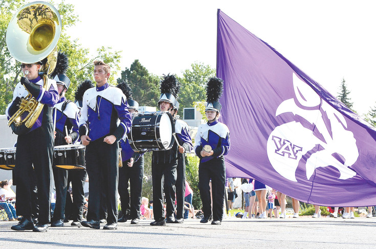 The Arvada West High School band marches in the Harvest Festival Parade on Saturday, Sept. 9.