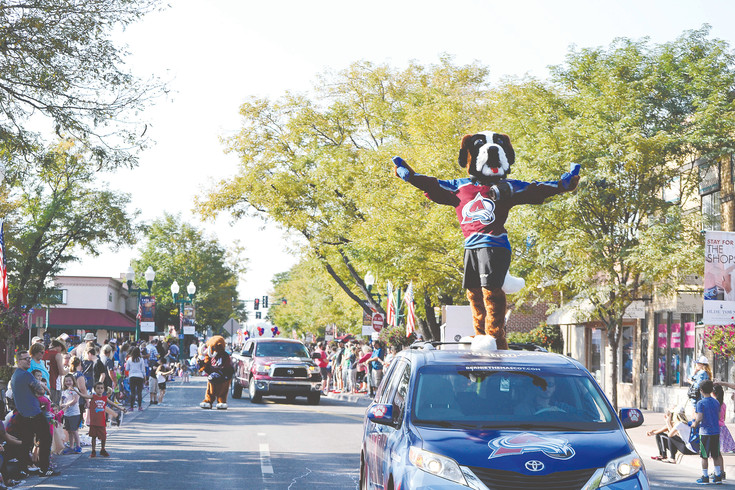Bernie, the Colorado Avalanche mascot, rides through the Arvada Harvest Festival parade on Saturday, Sept. 9.
