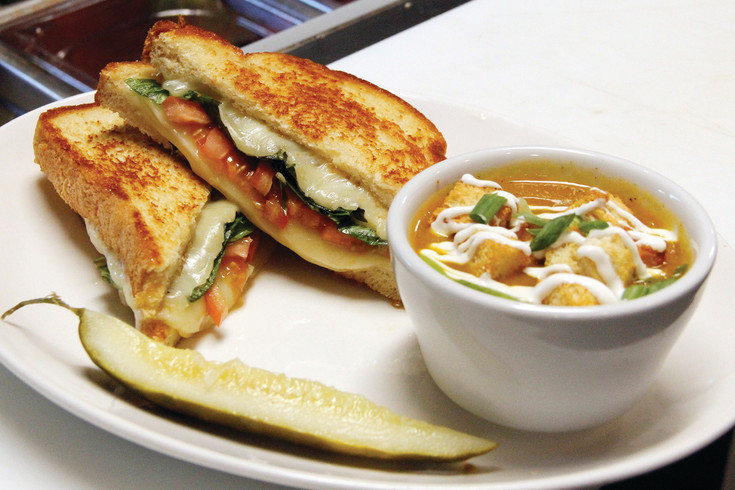 A grilled cheese featuring basil, tomato and honey, paired with carrot and onion soup, awaits a hungry customer at the Urban Egg.