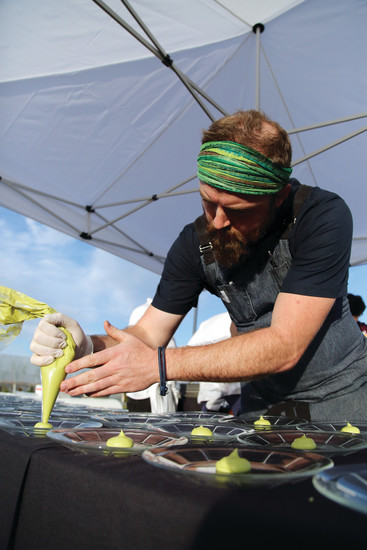 Chef Blake Edmunds, of Señor Bear, preps plates to serve the first course of the seven-course meal.
