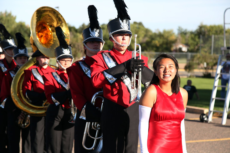 Drum Major Kaena Thanmasene prepares to lead the Arvada High School marching band onto the field for the first competition of the season.