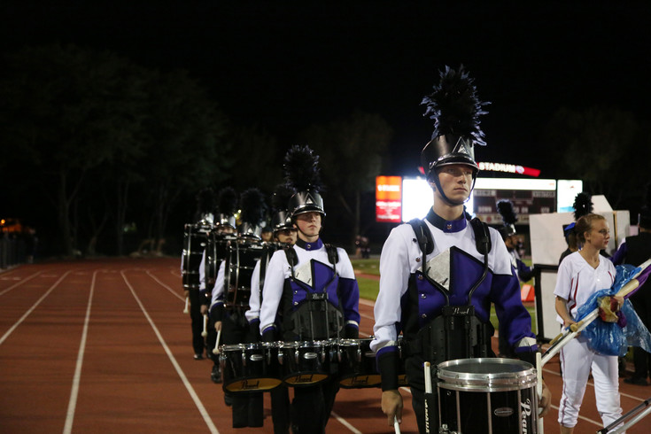 The Arvada West High School drum line prepares to take the field.