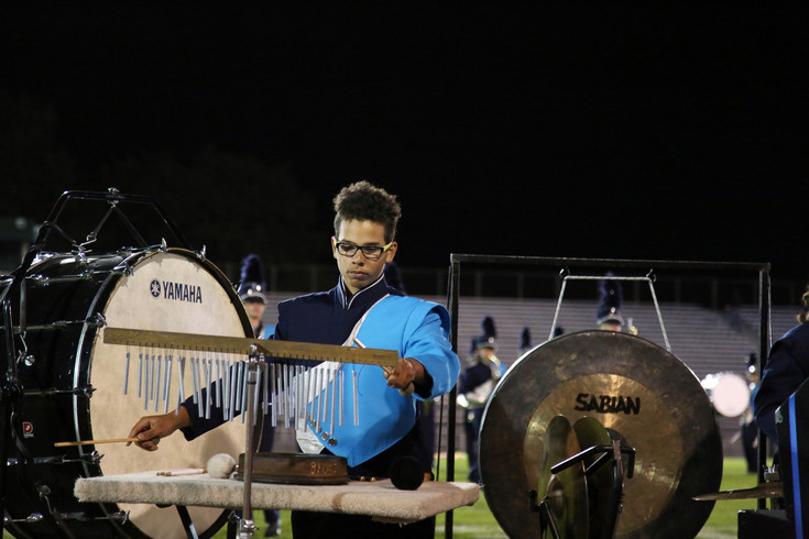 Jakub Jackson plays percussion with the Ralston Valley marching band Sept. 19.