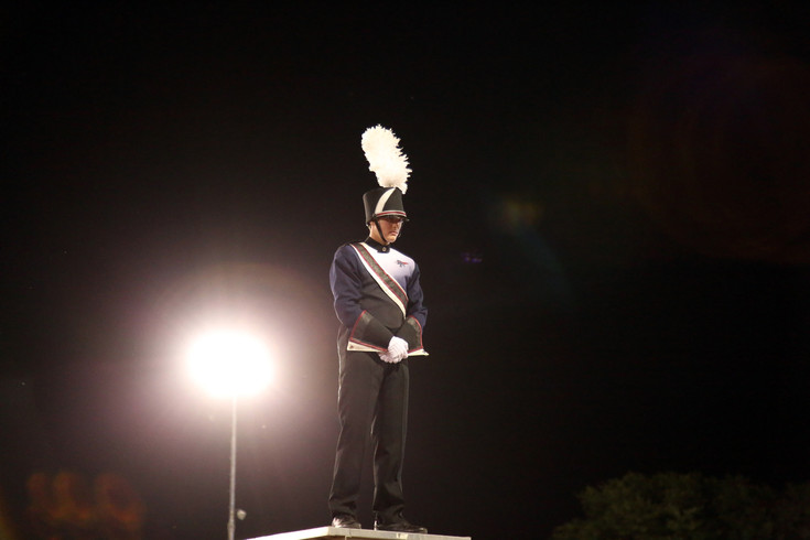 Drum Major Conor Eaton, senior, stand ready before directing the performance of teh Dakota Ridge High School Screamin' Eagles Marching Band.