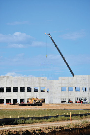 A crane lifts part of Amazon's new Thornton warehouse into place. The new warehouse is still on track to open in 2018 even as Metro North officials look to become the new home for Amazon's second headquarters, announced Sept. 7.