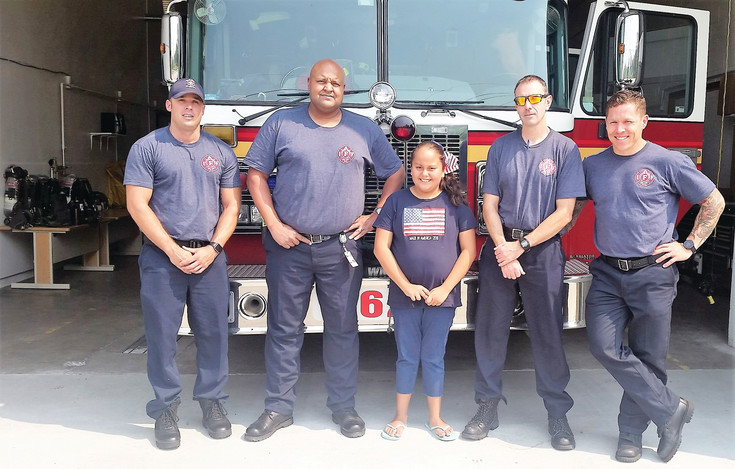 North Metro Fire District credits volunteers like Nykol Bustos, 10, of Northglenn, for helping them set a fundraising record at this Labor Day's Fill the Boot campaign for the Muscular Dystrophy Association.