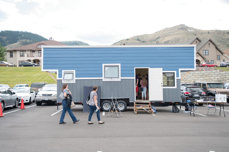 A group of people visit the Mines Tiny Home during the Colorado School of Mines' Celebration of Mines event at the beginning of this school year. Although not all the way complete, the net-zero tiny house was open for tours to recruit new students to the team.