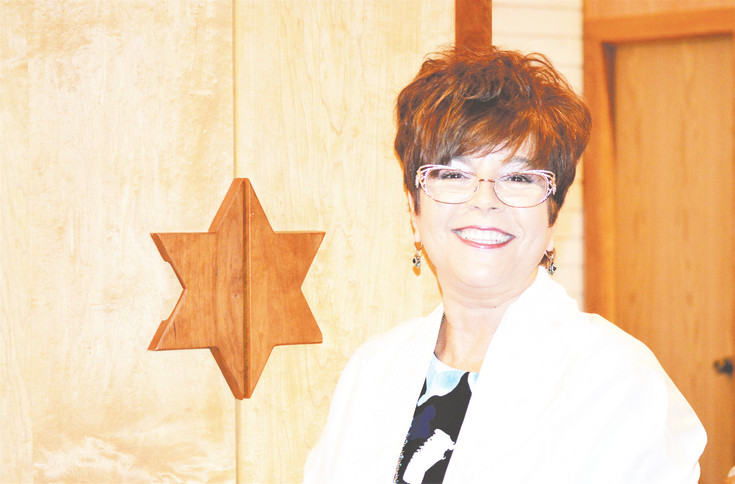 Rabbi Anat Moskowitz of Westminster's Congregation B'Nai Torah loves to travel and to fold stories  from  Star Wars into her sermons.