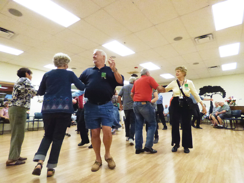 First-timers pair with old-timers at the Mountaineers square dancing club's introductory night.