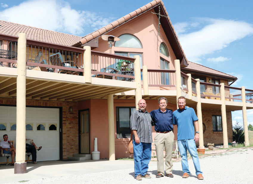 "Step Seven Executive Director Thom Straley, left, founder and pastor Tom Roth and program director Brian Laney stand outside of one of Step Steven's five sober living homes for men in east Parker. ""We share Jesus with the addicted,"" Straley said."