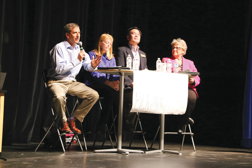 "From left, Anthony Graziano, Krista Holtzmann, Kevin Leung and Chris Schor, candidates on what moderators called the ""Community"" side, participate in the first forum at Highlands Ranch High School on Sept. 26."
