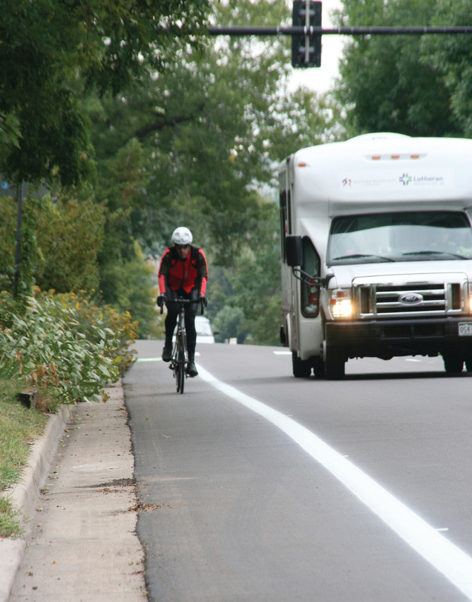 A cyclist rides his bike in a marked bike lane on Sept. 26 on Ford Street in Golden.