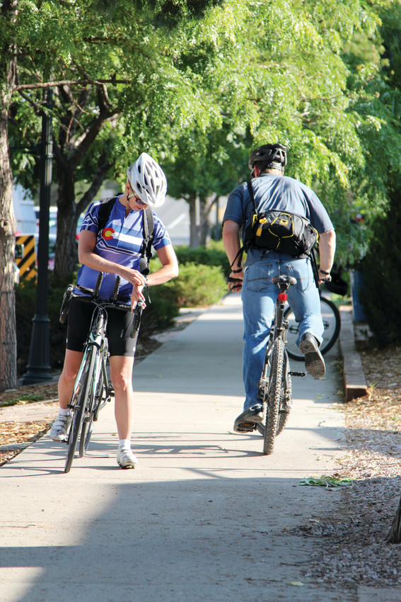 Some 2017 Bike to Work Day cyclists in Castle Rock make use of a sidewalk. Tom Reiff, the Castle Rock transportation planner, said the town has been adding bike lanes as it fixes or creates new roads, in order to support multimodal transportation.