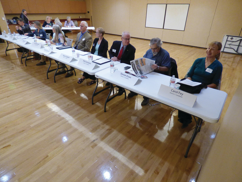 Littleton's nine city council candidates prepare for a candidate forum at Buck Recreation Center on Sept. 28.