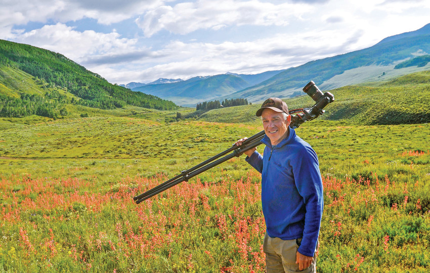 John Fielder embarks on a hike with his large format film camera to capture Colorado's unique fall colors. Fielder prefers a smaller digital camera for most outings now, accompanied by a pack llamas in place of human assistants.