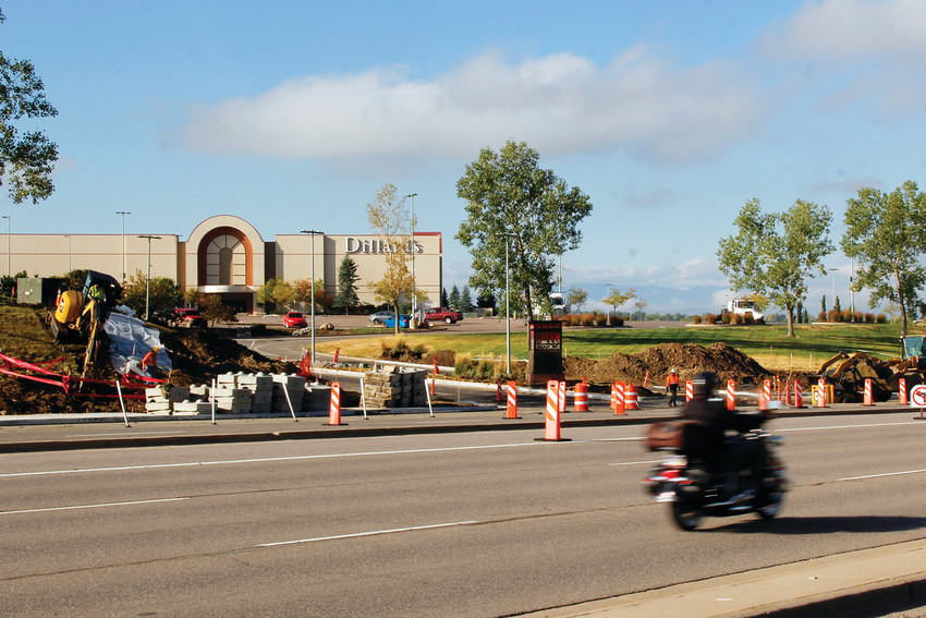 "A lone motorcycle speeds past the construction at the northeastern entrance, dubbed ""the P.F. Changs entrance"" at Park Meadows. The entrance will soon have a left turn lane at the entrance as well as another exit lane onto eastbound County Line Road."