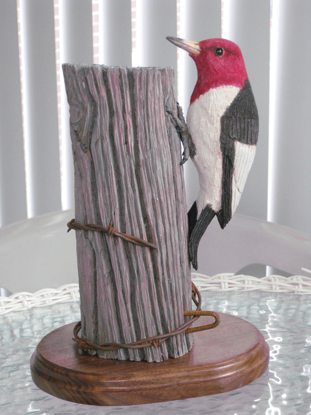 A Red-Headed Woodpecker, carved and painted by Ralph Mueller, will be available at the Woodcarvers Oct 14-15 show and sale at the Hilton Garden Inn in Highlands Ranch.