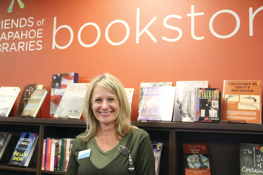 Jill Kahan, a library specialist at Koelbel Library in Centennial, stands in its bookstore section Sept. 27. Kahan, a longtime Centennial resident, said she enjoys the diversity and inclusion local libraries have to offer.
