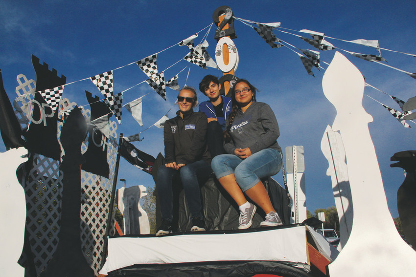 Sophomores Jessica Albert, left; Christopher Uriarte, middle; and HeavenLee Escobar sit on the homecoming float at Englewood High School's tailgate event before the homecoming football game Oct. 6. Escobar and Albert are in the EHS student government, and all three students worked on the float.