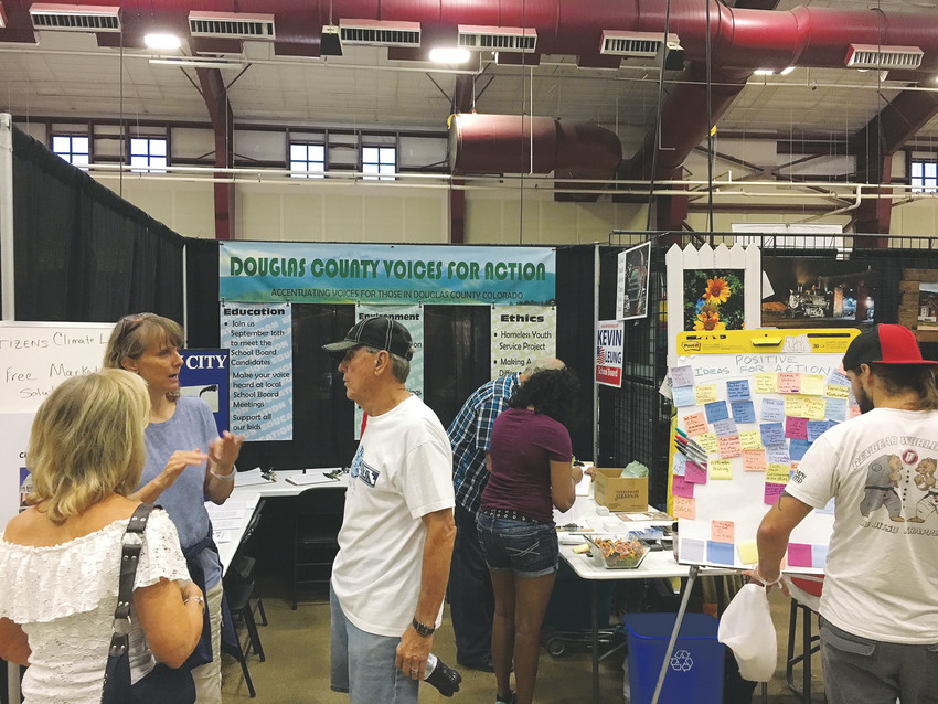 Volunteers at the Voices for Action booth talk climate change with attendees at the Douglas County Fair and Rodeo in 2017. Citizens Climate Lobby members, many of whom are also involved with Voices, hope to engage Douglas County residents on nonpartisan solutions to climate change at an upcoming meeting at the Parker library at 2 p.m. on Oct. 21.