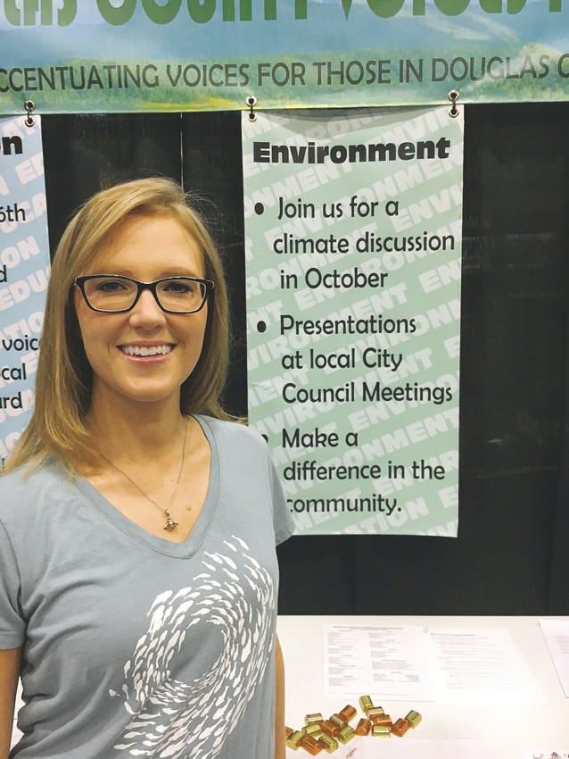 Parker resident Jamie VanDegrift,  a member of the Citizens Climate lobby since February, stands tall before a display of action issues at the 2017 Douglas County Fair and Rodeo. VanDegrift said many people who visited the booth she worked expressed relief that there were groups in the historically conservative area willing to take action on climate change.