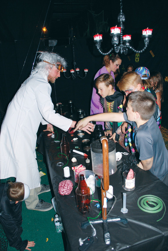 A mad scientist at the Parker Fieldhouse dishes out some knowledge and candy at the 2016 Fieldhouse Fright Night. Children and parents can compete in a family costume contest, as well as individual competitions organized by age.