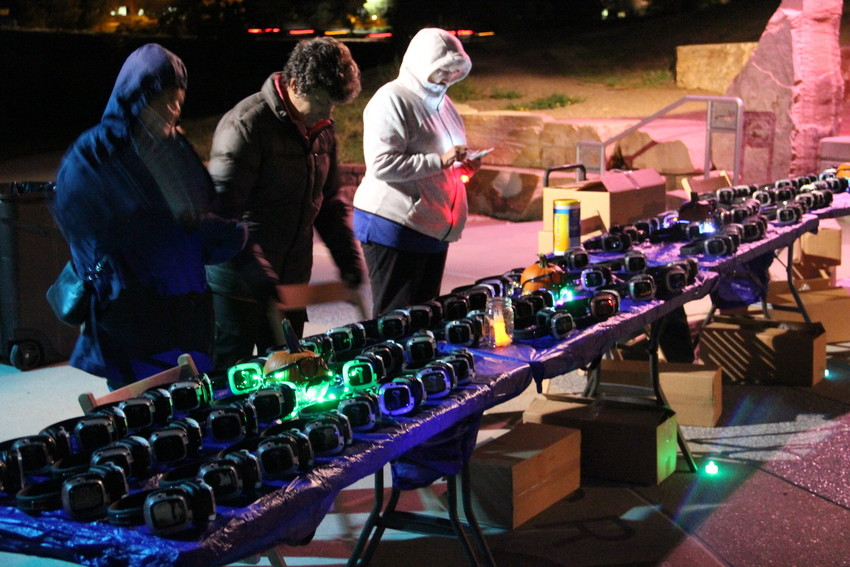 TOP: Light-up, cordless headphones sit on tables for attendees, supervised by chaperones from the Centennial Senior Commission, at a silent disco event put on by the city at Centennial Center Park Oct. 6. The city's Youth Commission had the idea for the event.