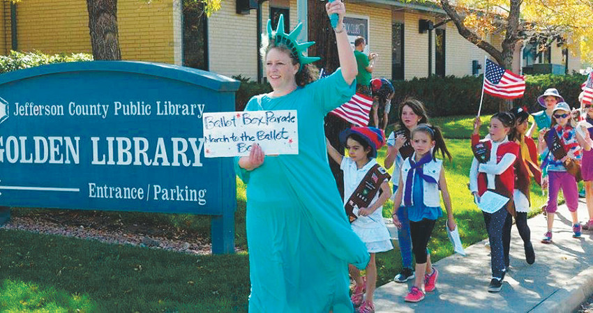 Christina DeMink as Statue of Liberty leads some of Golden's voters of tomorrow past the library to the ballot box at city hall during the 2015 March to the Ballot Box event. This year's event on Oct. 21 is being put on by Golden Votes, a volunteer-run, nonpartisan group with a purpose to urge all eligible voters to vote this November.