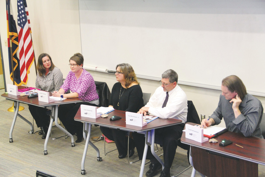 From left, Tena Prange, Jennifer Hubbard, Caty Husbands, Carl Montegna and Todd Fahnestock, candidates for the Englewood Schools Board of Education, at an Oct. 11 forum at the Englewood Campus. There are three seats up for election this year.